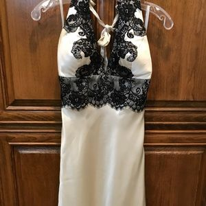 White silk with black lace. Halter top.